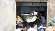 Tarsus'ta Bir Evden 8 Kamyon Çöp Çıkarıldı