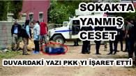 Sokakta yakılmış ceset bulundu! Duvardaki PKK yazısı tüm gözleri terör örgütüne çevirdi